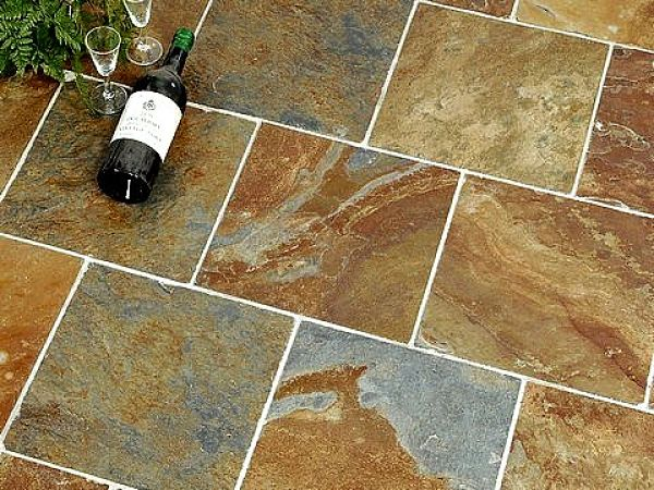 Slate tiles are vulnerable to staining through wine spills and other acid foods and drinks. They can be very hard to clean. Learn the secrets here.